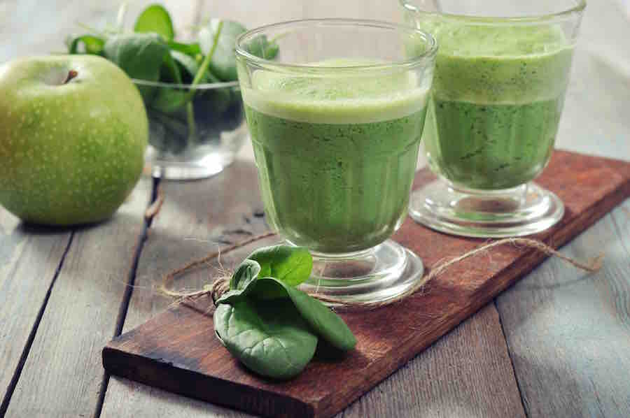 Healthy green smoothie with green apples and spinach